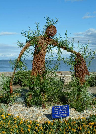 The centrepiece of the gardens is the figure of a fisherman woven from live willow