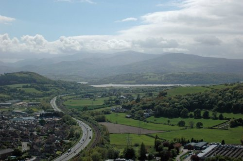 The A55 snakes towards  the Conwy Estuary with view of Snowdonia beyond