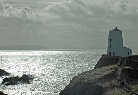 Lighthouse, Twyr Mawr, sparkling sea and a background of the Llyn Peninsular