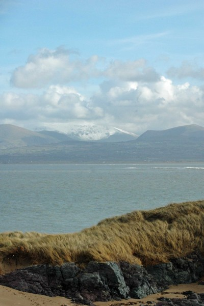 Snow-capped mountains across the bay