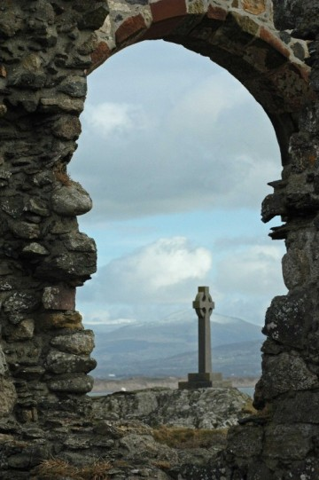 St Dwywen's Cross & mountain view through the chapel arch