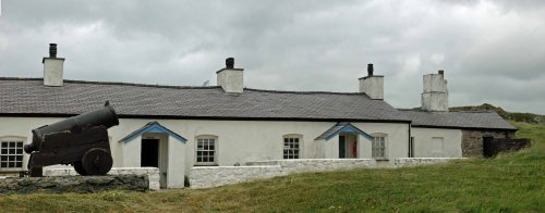 The Pilot's cottages and cannon