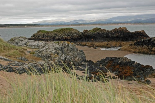 A view from the island across the 'bottom' end of Newborough Warren and Caernarfon Bay to Snowdonia, where some of the mountains were in sunshine