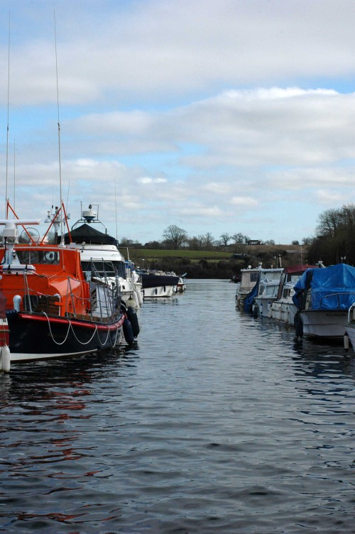 Boats and barges moored on the canal